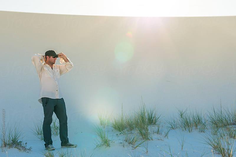 Man Resting In Shade of Desert Sand Dune In White Sands National Monument New Mexico by JP Danko for Stocksy United