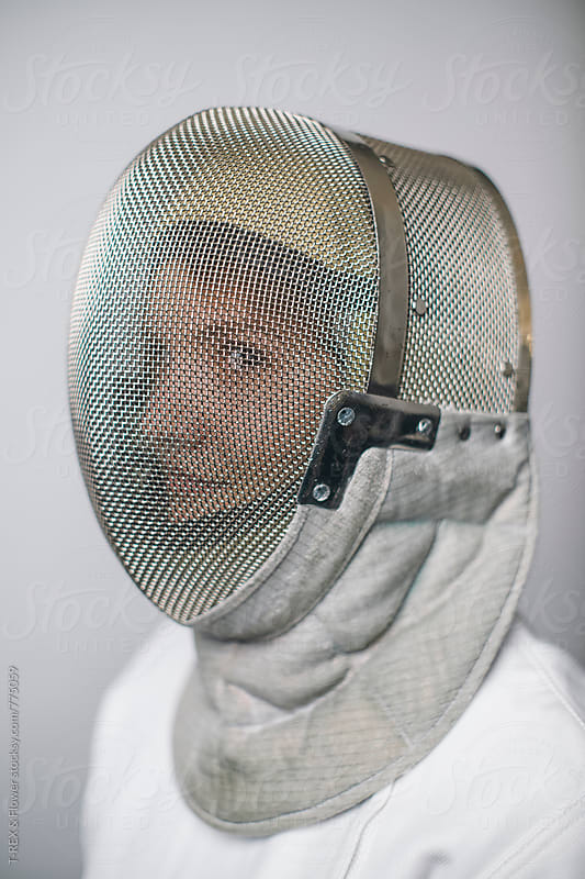 Female fencer wearing mask by Danil Nevsky for Stocksy United