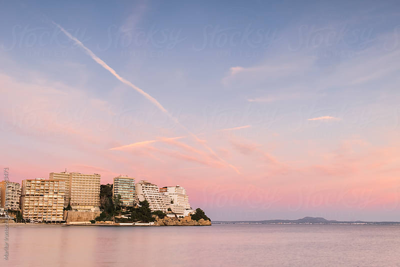 Apartment buildings in the Majorcan coast at sunset by Marilar Irastorza for Stocksy United