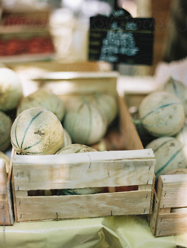 Melons at a market in France by Kirstin Mckee for Stocksy United