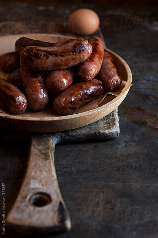 Plate of sausages by Nadine Greeff for Stocksy United