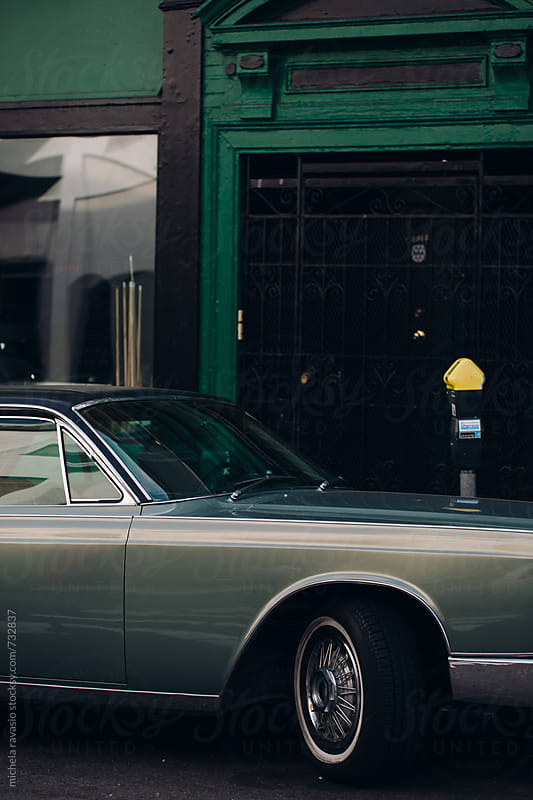 Vintage car parked in the street by michela ravasio for Stocksy United