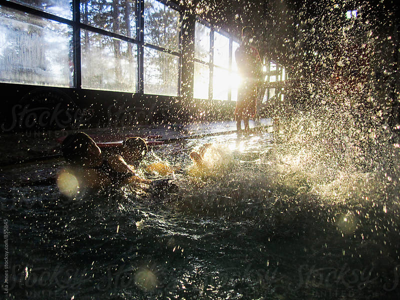 kids playing in a pool.  big splash  by Léa Jones for Stocksy United