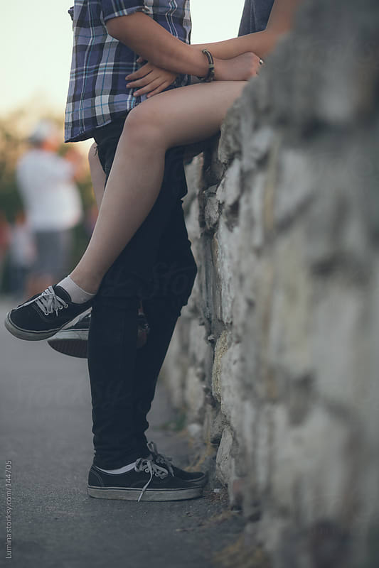 Teenage Couple Sitting on a Wall by Lumina for Stocksy United