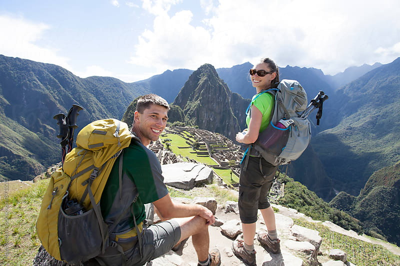 Couple trekking at Machu Picchu. Cusco. Peru. by Hugh Sitton for Stocksy United