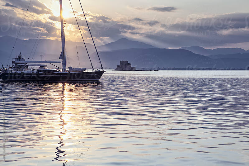 Moored ship in Nafplio harbour by Ivan Bastien for Stocksy United