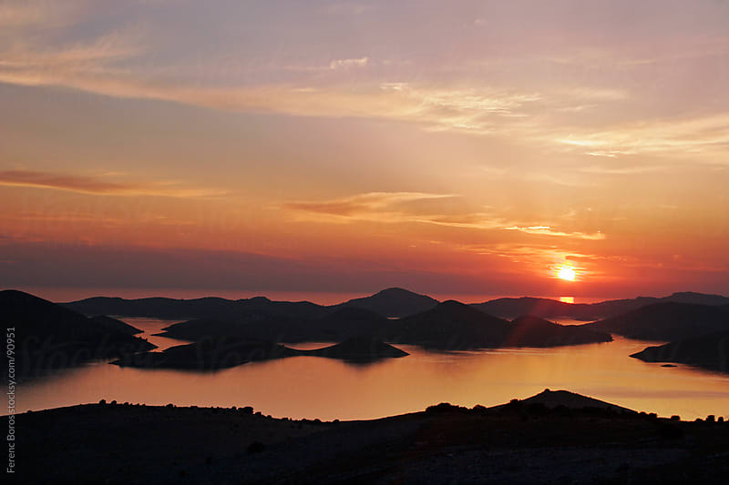 Silhouette of Kornati islands at sunset by Ferenc Boros for Stocksy United