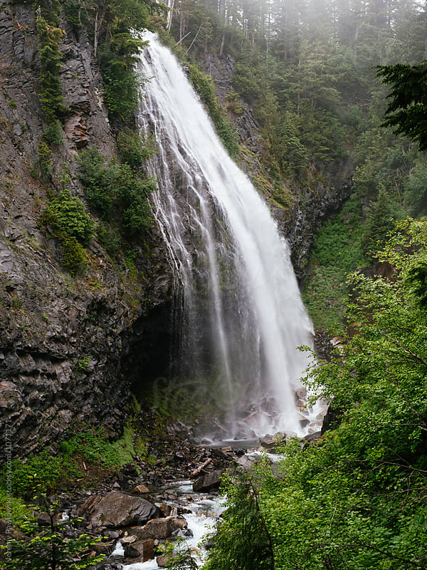 Misty waterfall on gloomy pacific northwest day by Jeremy Pawlowski for Stocksy United