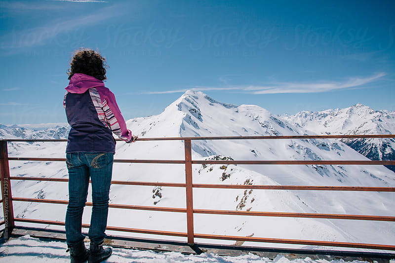 Woman on top of the alps by Davide Illini for Stocksy United