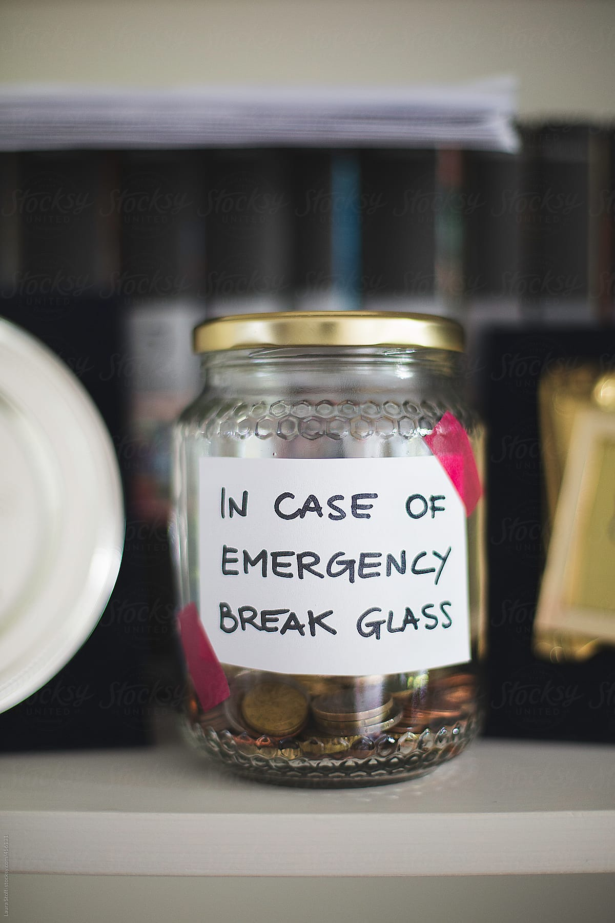 Saving Money Jar Lebelled With In Case Of Emergency Break Glass