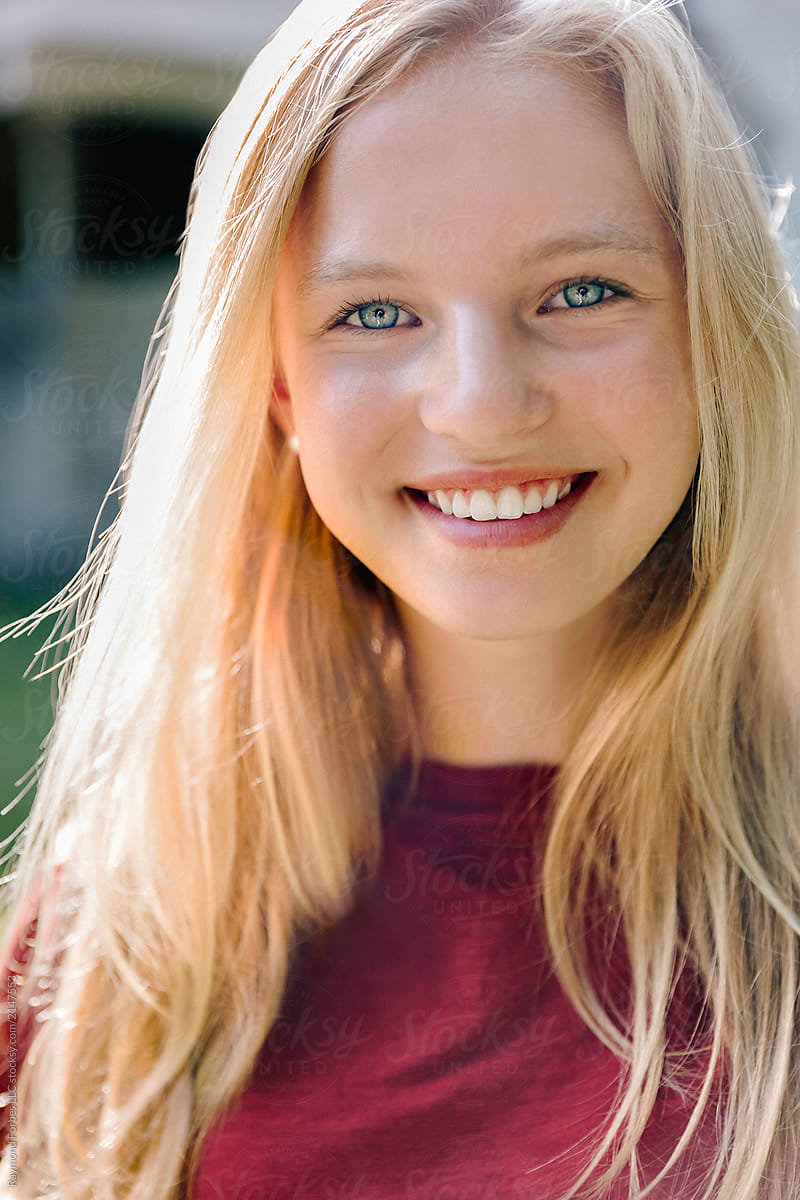 Portrait of beautiful Blond Teen with Blue Eyes Girl