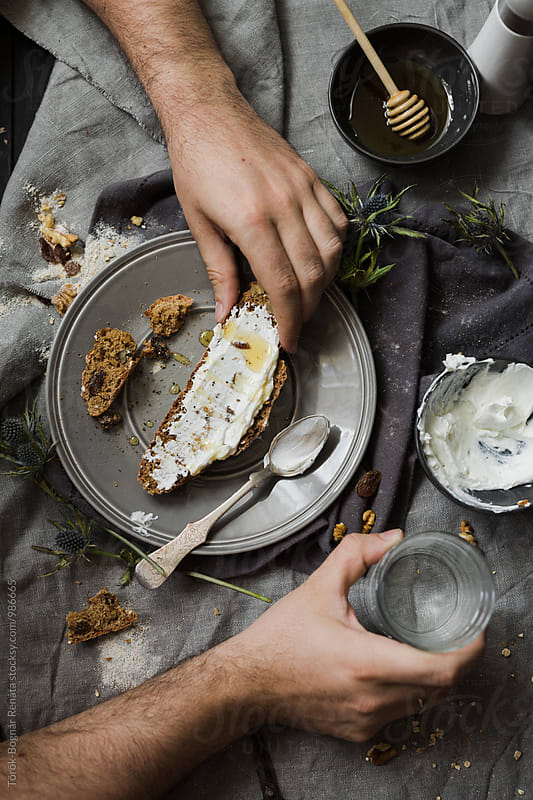 Homemade oat sodabread slice with creamy goat cheese by Török-Bognár Renáta for Stocksy United