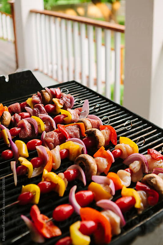 Kebabs on the Grill  by Raymond Forbes LLC for Stocksy United