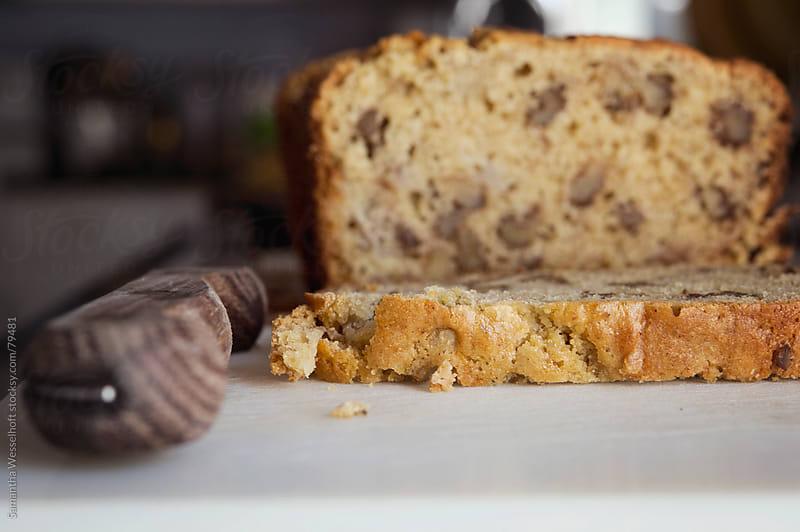 banana bread on a cutting board by Samantha Wesselhoft for Stocksy United