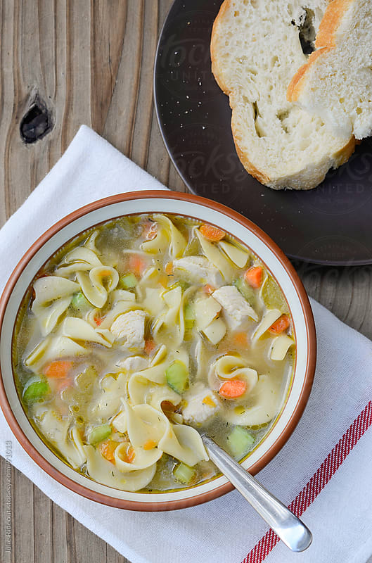 Homemade Chicken Noodle Soup by Julie Rideout for Stocksy United