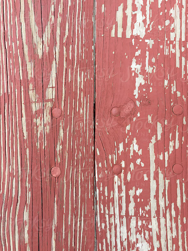 Cracked red paint, background by Adam Nixon for Stocksy United