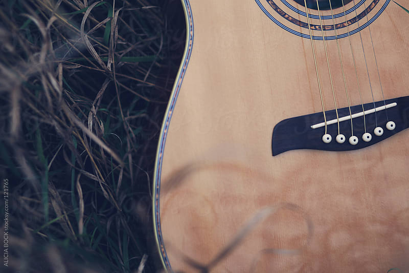 Guitar In The Grass by ALICIA BOCK for Stocksy United