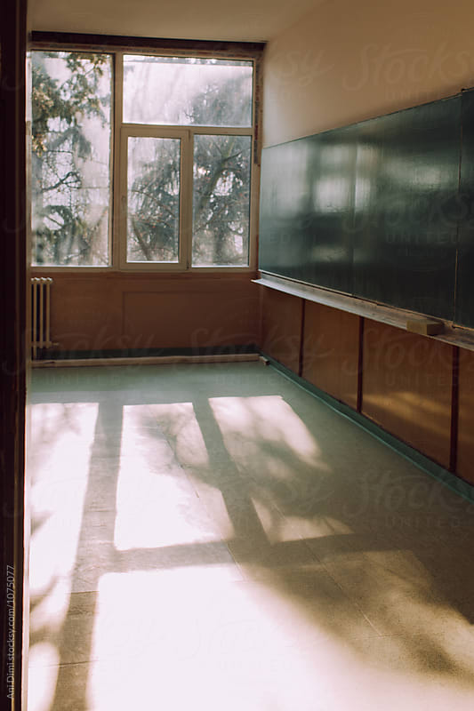 light entering classroom  by Ani Dimi for Stocksy United