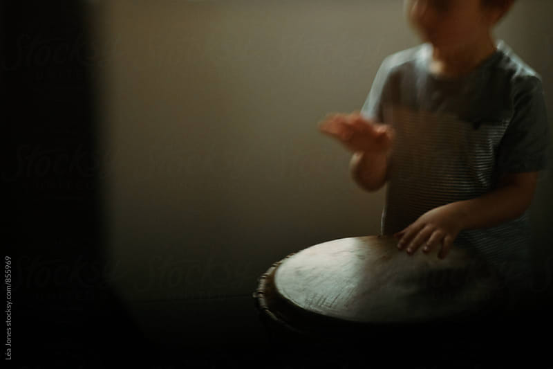 Young child drumming by Léa Jones for Stocksy United