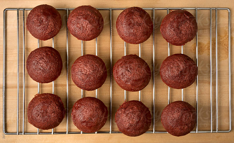 Cooling Red Velvet Cupcakes by Jeff Wasserman for Stocksy United