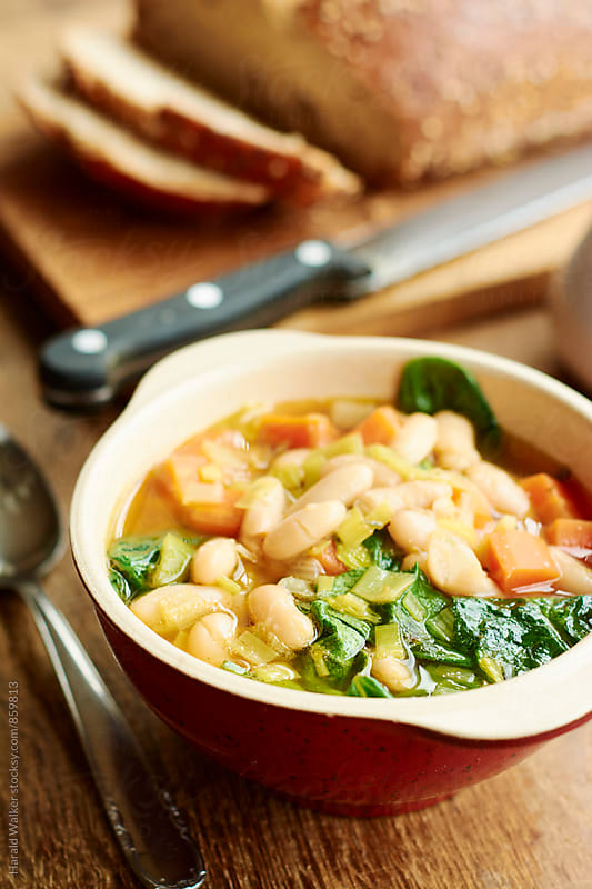 White Bean Soup with Spinach by Harald Walker for Stocksy United