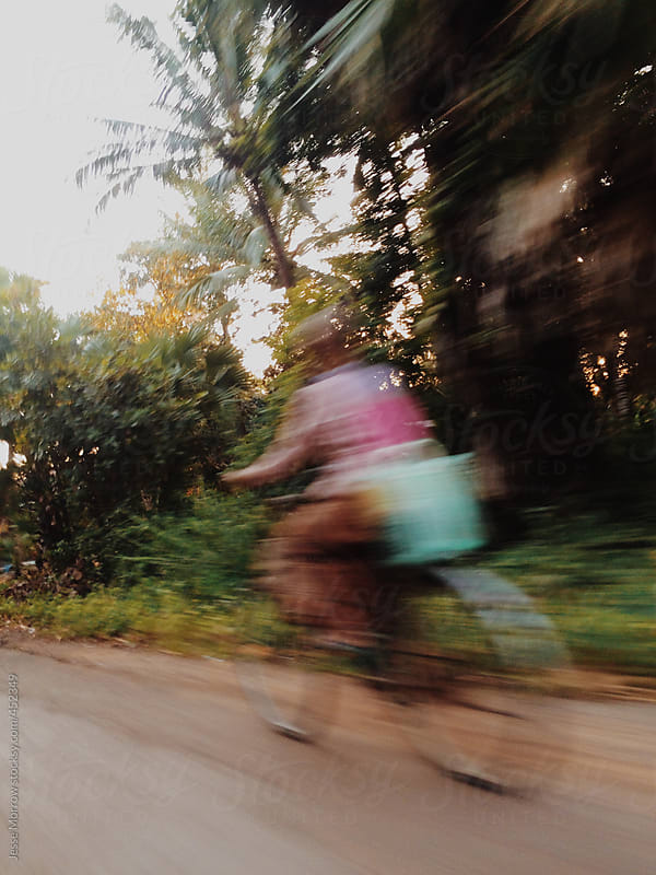 biker rides through asian jungle by Jesse Morrow for Stocksy United