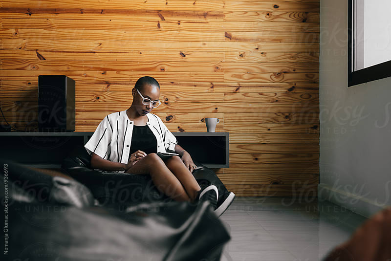 African American Woman Sitting Relaxed in a Lazy Bag by Nemanja Glumac for Stocksy United