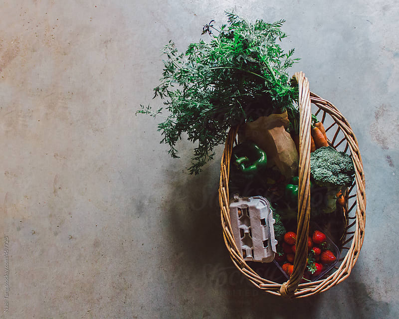Basket full of organic fruits and vegetable by Nabi Tang for Stocksy United