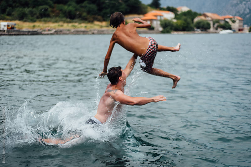 Two crazy friends having fun on sea by Boris Jovanovic for Stocksy United
