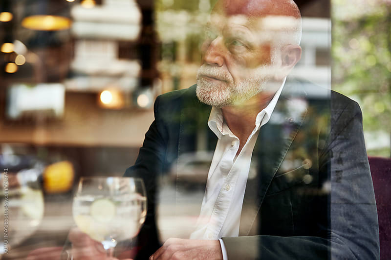 Senior Man In Restaurant by ALTO IMAGES for Stocksy United