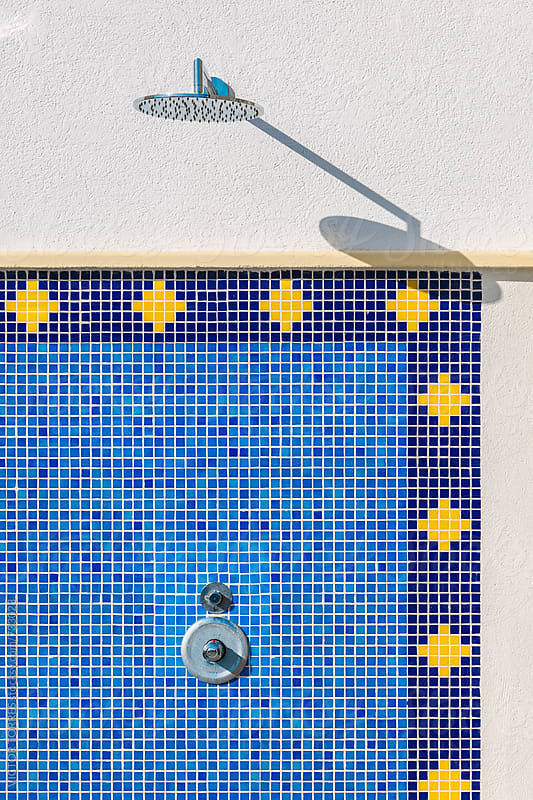 Pool Shower with a Blue Mosaic Wall by Victor Torres for Stocksy United