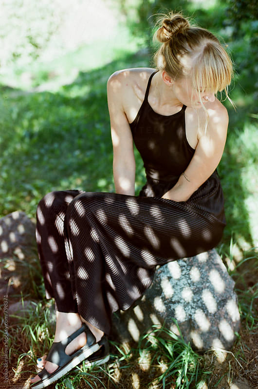 Blonde woman in sun spots by Lyuba Burakova for Stocksy United