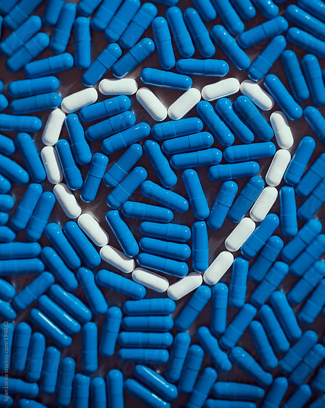 Medicine: Pills Outline Heart With Blue Capsules by Sean Locke for Stocksy United