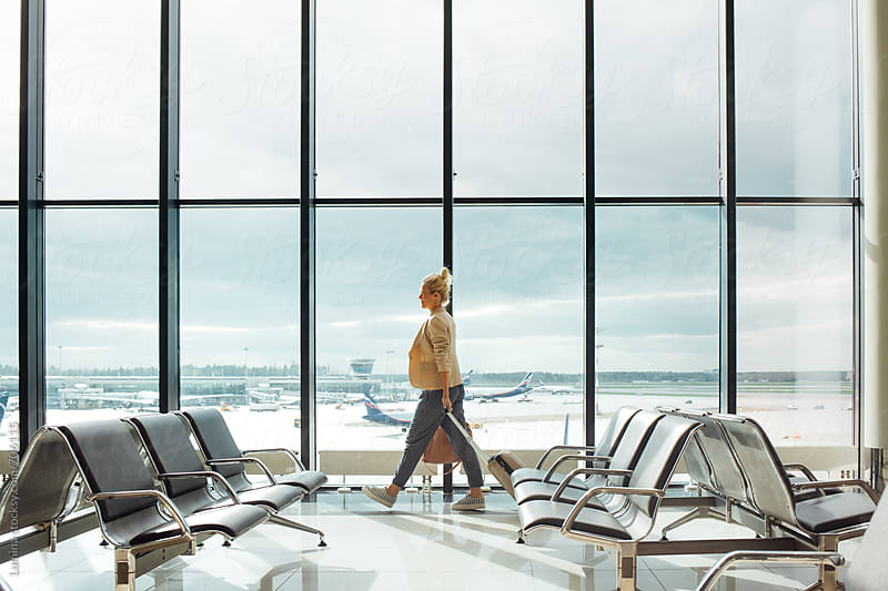 Blonde Woman at the Airport by Lumina for Stocksy United