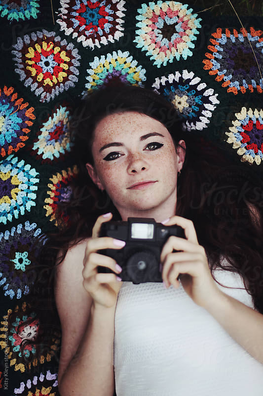 Girl holding her camera by Kitty Gallannaugh for Stocksy United