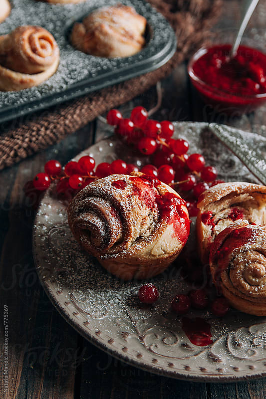 Homemade cinnamon rolls with raspberries glaze by Nataša Mandić for Stocksy United
