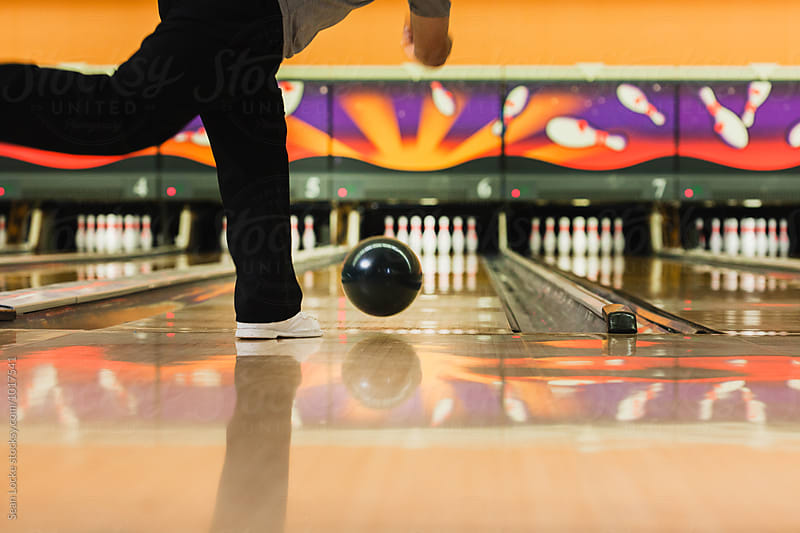 Bowling: Male Throwing Ball Down Alley by Sean Locke for Stocksy United