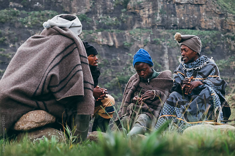 A group of Basotho herdsmen sitting and talking in the mountains by Micky Wiswedel for Stocksy United