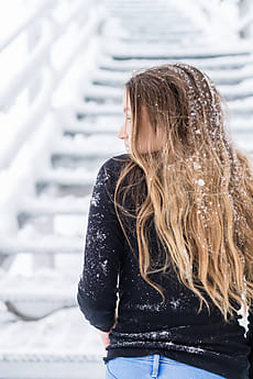 c9aeb3e63b72 teen girl with snow in her hair by Gillian Vann for Stocksy United