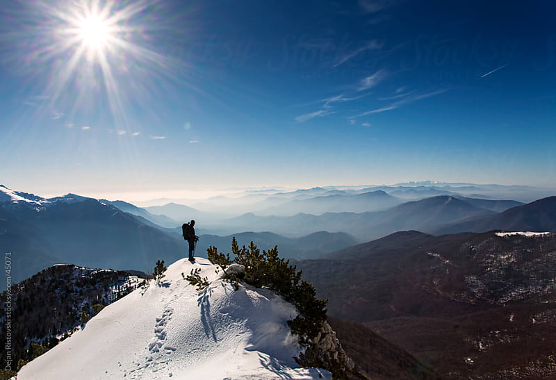 Mountaineer observes beautiful nature by Dejan Ristovski for Stocksy United