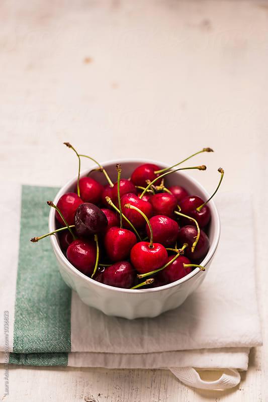 Bowl full of freshly picked cherries by Laura Adani for Stocksy United