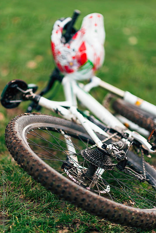 Mountain bike one the grass by Dimitrije Tanaskovic for Stocksy United
