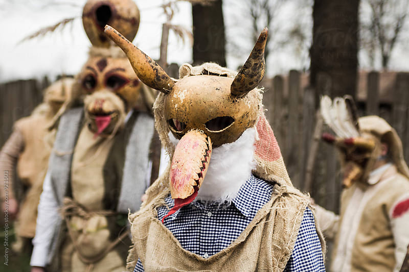 Young peolpe during old slavic festival dressed like forest spirits   by Marko Milanovic for Stocksy United