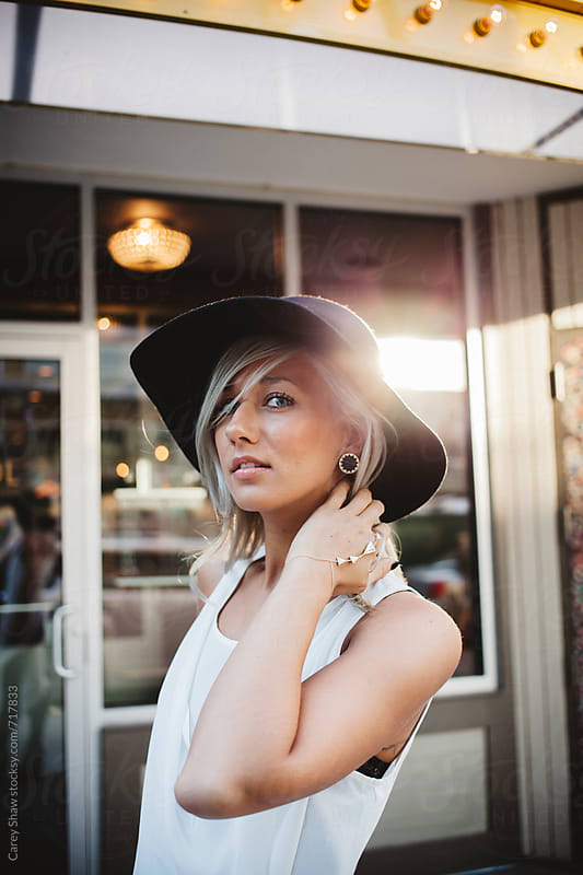 Attractive young woman wearing stylish hat by Carey Shaw for Stocksy United