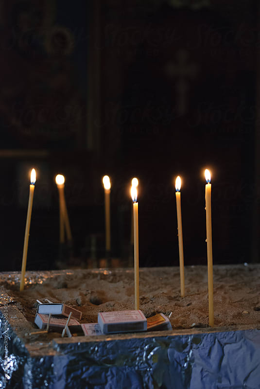 Candles in church by Pixel Stories for Stocksy United