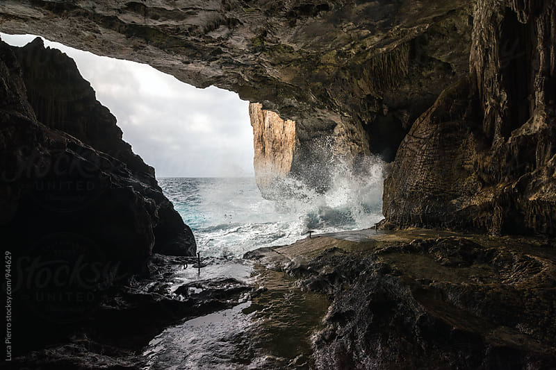 View of agitated water from a cave by Luca Pierro for Stocksy United