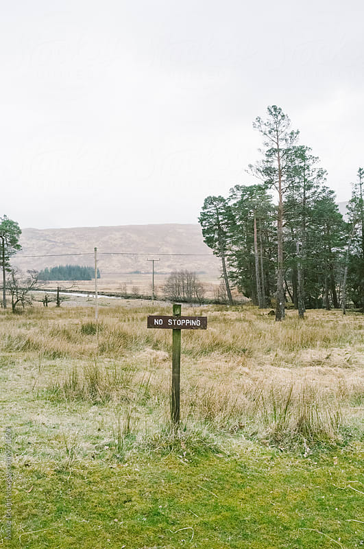 A no stopping sign in the Scottish Highlands by Ivo de Bruijn for Stocksy United