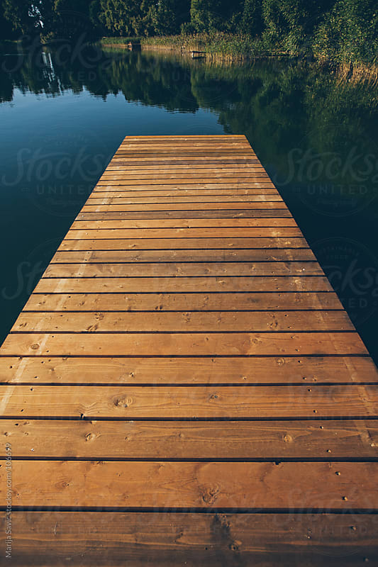Wooden dock on a lake. by Marija Savic for Stocksy United