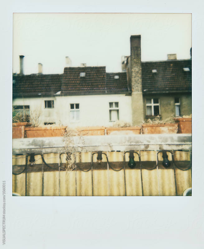 Instant Photograph of Balcony and Old Berlin Apartment Building Roofs by Julien L. Balmer for Stocksy United