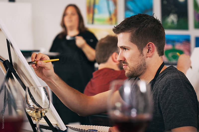 Painting: Learning To Paint As Teacher Instructs Class by Sean Locke for Stocksy United